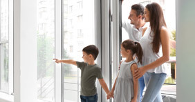 A young family looks at a new home